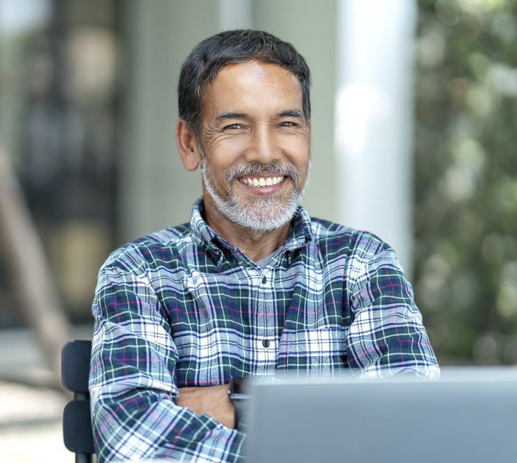 Portrait of happy mature man with white, grey stylish short bear