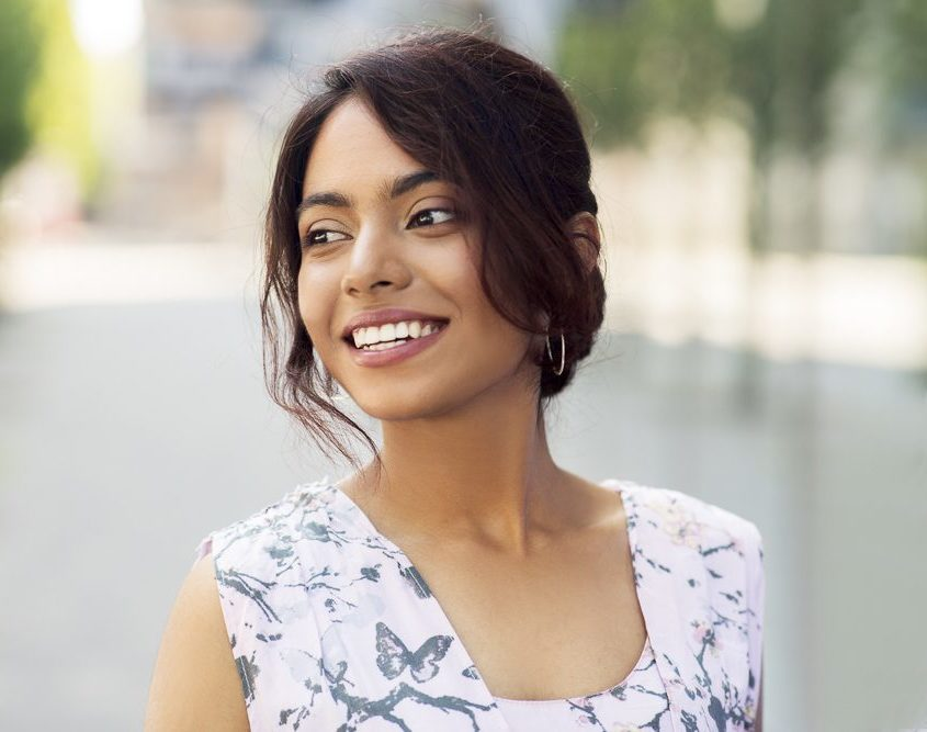 portrait of happy smiling indian woman outdoors