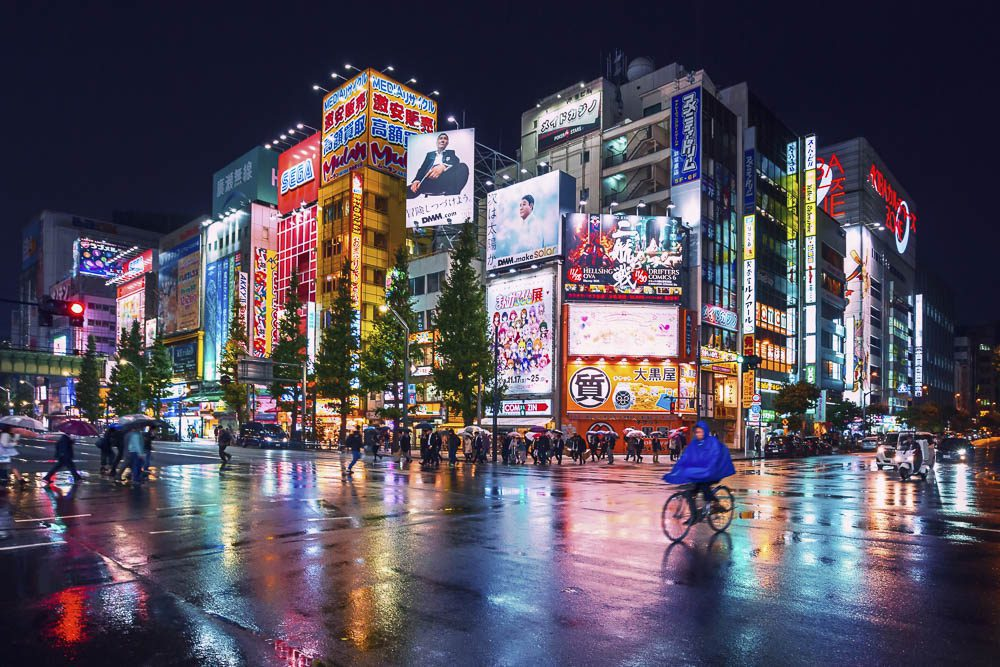 Neon lights and billboard advertisements on buildings at Akihabara at rainy night, Tokyo, Japan
