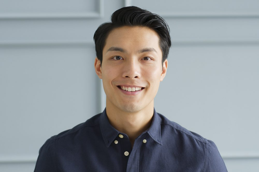 Portrait young confident smart Asian businessman look at camera
