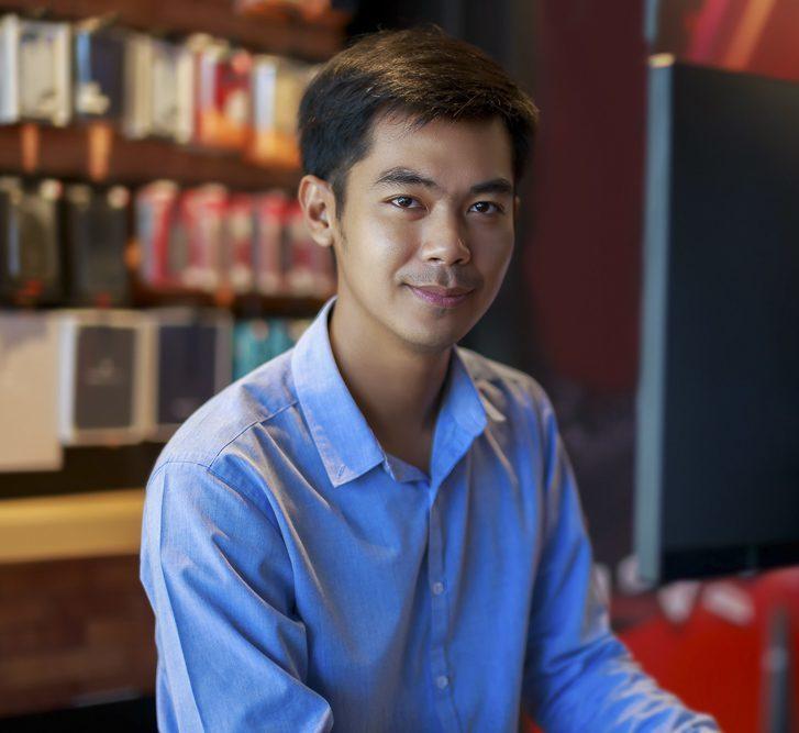 asian businessman looking at camera